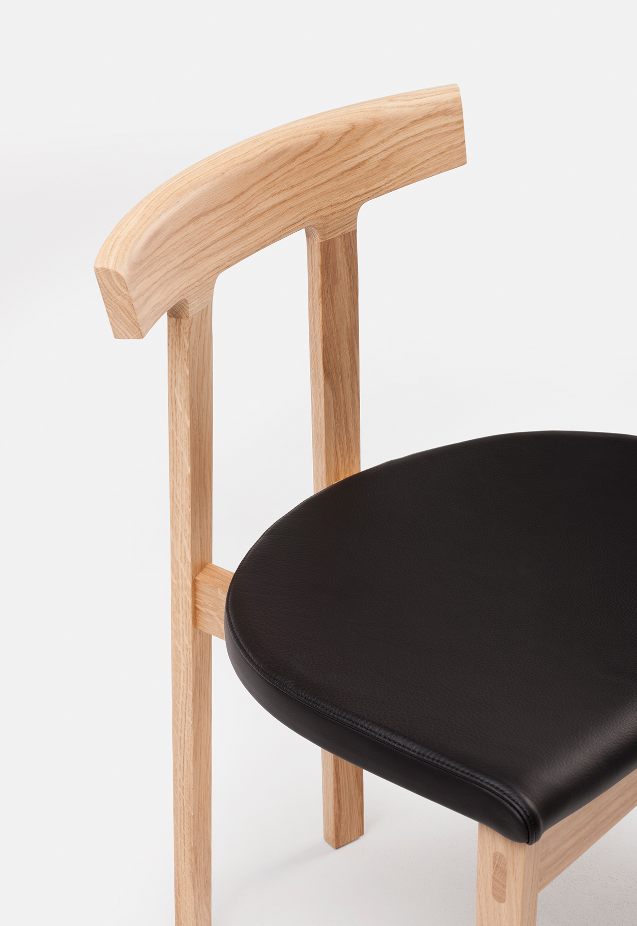 Torii Chair in white oak, black leather upholstered seat