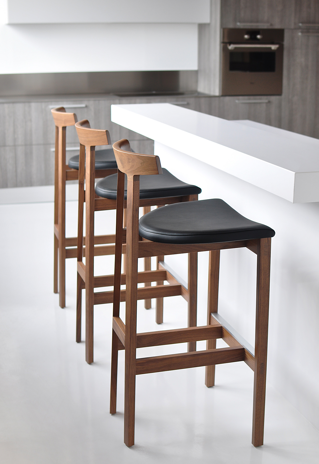 Torii Stool in walnut, black leather